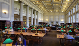 View of the Society's two-story library with students reading at tables.