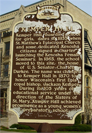 Photograph of the Wisconsin State Historical Marker for Kemper Hall with chipping paint.