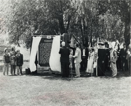 Photograph of a gathering of people at the dedication of the historic marker for Marquette.