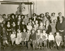 "Pupils of the Northey School, District No. 7, pose with their parents at a Halloween ""Hard-time"" party at the school."