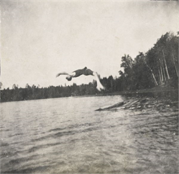 Wallace Rumsey Doing a Back Flip Dive into Archibald Lake