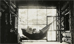 I.P. Rumsey Reading in the Hammock at Island Lodge