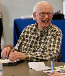 "Ken Germanson, president emeritus of the Wisconsin Labor History Society, laughs during the ""Share Your Voice"" session in Kenosha. ""When you're talking about industry, you have to talk about the working people,"" he said."