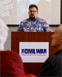"Nick Wiersum, Curator of Natural History Education for the Kenosha Public Museums, welcomes guests to the Civil War Museum in Kenosha for the Wisconsin Historical Society's ""Share Your Voice"" new museum listening session May 22, 2019."