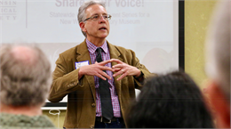"UW-Milwaukee history professor Joe Rodriguez welcomes guests to the United Community Center May 15, 2019 for the Wisconsin Historical Society's ""Share Your Voice"" new museum multicultural listening session for the Latinx community of Milwaukee."