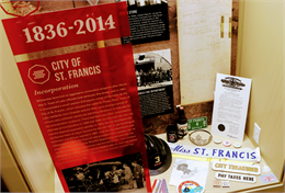 The St. Francis Historical Society uses built-in display cabinets in the lobby of the St. Francis Civic Center to share the story of their city.