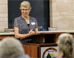 "Anna Passante, Executive Director of the St. Francis Historical Society, shares the story of her organization in her welcome remarks at the Wisconsin Historical Society's ""Share Your Voice"" listening session at the St. Francis Civic Center."