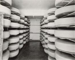 Stacks of cheese, One of the twelve photographs included in the Society's first calendar, 1948