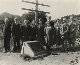 Group portrait of attendees at a ceremony to place a marker on the former site of the French post of Nicolas Perrot.